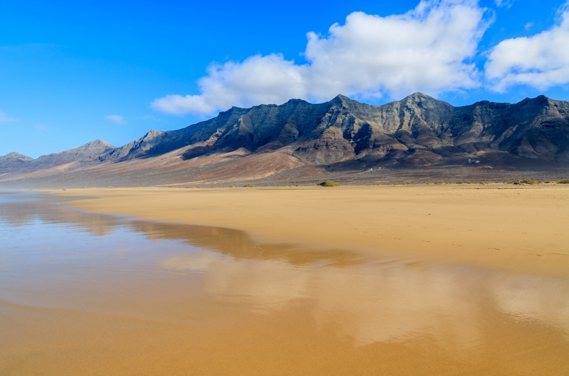 'Reflection of mountains in wet sand on Cofete beach in secluded part of Fuerteventura, Canary Islands, Spain' - Canary Islands