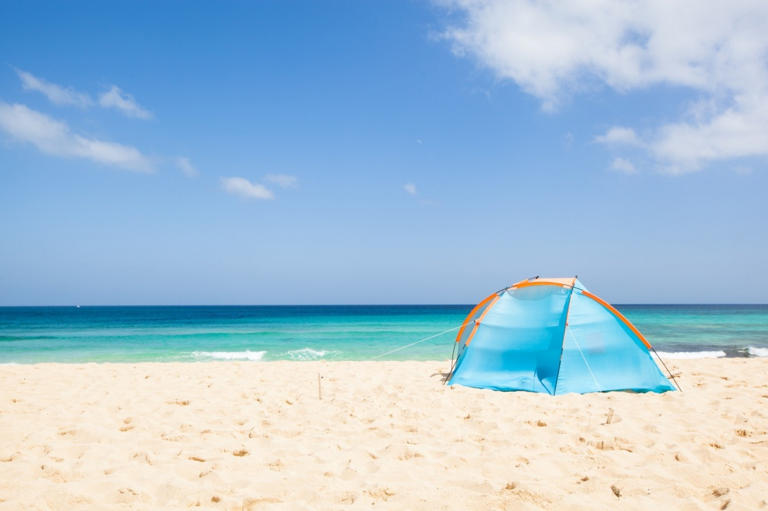 'camping with a tent at a lonesome beach with a turquoise sea and blue sky in the background, Fuerteventura, Canary Islands, Spain, Europe' - Canary Islands